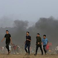 Protesters near the Gaza Strip border with Israel east of Khan Younis, southern Gaza Strip, Friday, October 19, 2018. (AP Photo/Adel Hana)