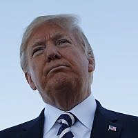 US President Donald Trump pauses as he speaks to media after a campaign rally before boarding Air Force One at Elko Regional Airport, Saturday, Oct. 20, 2018, in Elko, Nev., en route to Washington. (AP Photo/Carolyn Kaster)