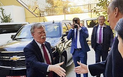US National Security Adviser John Bolton, left, is greeted by Russian Security Council chairman Nikolai Patrushev in Moscow, Russia, October 22, 2018. (Press Service of the Russian Security Council via AP)