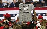 Illustrative: In this October 4, 2018 file photo, a Trump supporter holds up a T-shirt reading 'You Are Fake News' before a rally by President Donald Trump in Rochester, Minnesota. (AP Photo/Jim Mone, File)