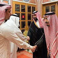 In this photo released by Saudi Press Agency, SPA, Saudi King Salman, right, and Crown Prince Mohammed bin Salman, second right, receive Sahel, a family member, and Salah, a son, of Jamal Khashoggi, in Riyadh, Saudi Arabia, on October 23, 2018. (Saudi Press Agency via AP)