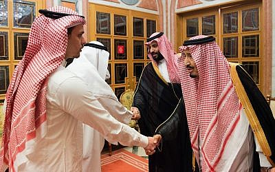 In this photo released by Saudi Press Agency, SPA, Saudi King Salman, right, and Crown Prince Mohammed bin Salman, second right, receive Sahel, a family member, and Salah, a son, of Jamal Khashoggi, in Riyadh, Saudi Arabia, on October 23, 2018. (Saudi Press Agency via AP)