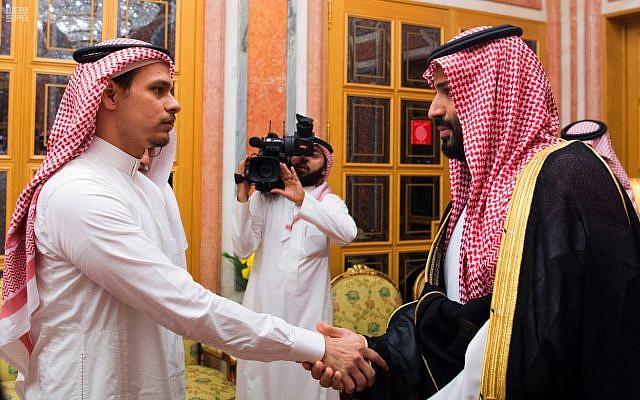 Saudi Crown Prince Mohammed bin Salman (right) shakes hands with Salah Khashoggi, a son of Jamal Khashoggi, in Riyadh, Saudi Arabia, October 23, 2018. (Saudi Press Agency via AP)