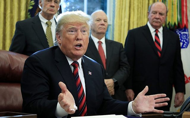 US President Donald Trump speaks, following a ceremony signing the 'America's Water Infrastructure Act of 2018' into law in the Oval Office at the White House on October 23, 2018. (AP Photo/Manuel Balce Ceneta)