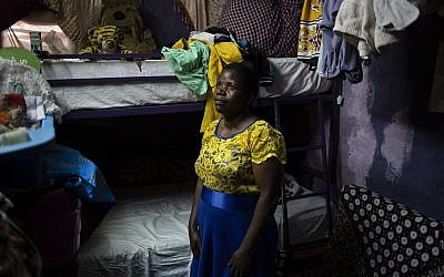 Margaret Oliele, former detained patient, poses for a portrait in her home in Nairobi, Kenya. (AP Photo/Bram Janssen)