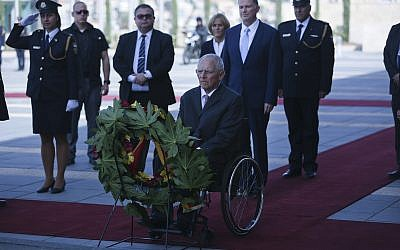 German Bundestag President Wolfgang Schaeuble pays his respects during a wreath-laying ceremony at the Memorial for Fallen Israeli Soldiers during his visit to the Knesset the Israeli parliament, in Jerusalem, October. 24, 2018. (AP Photo/Oded Balilty)