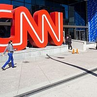 People walk outside CNN Center, in Atlanta, October 24, 2018. (Ron Harris/AP)