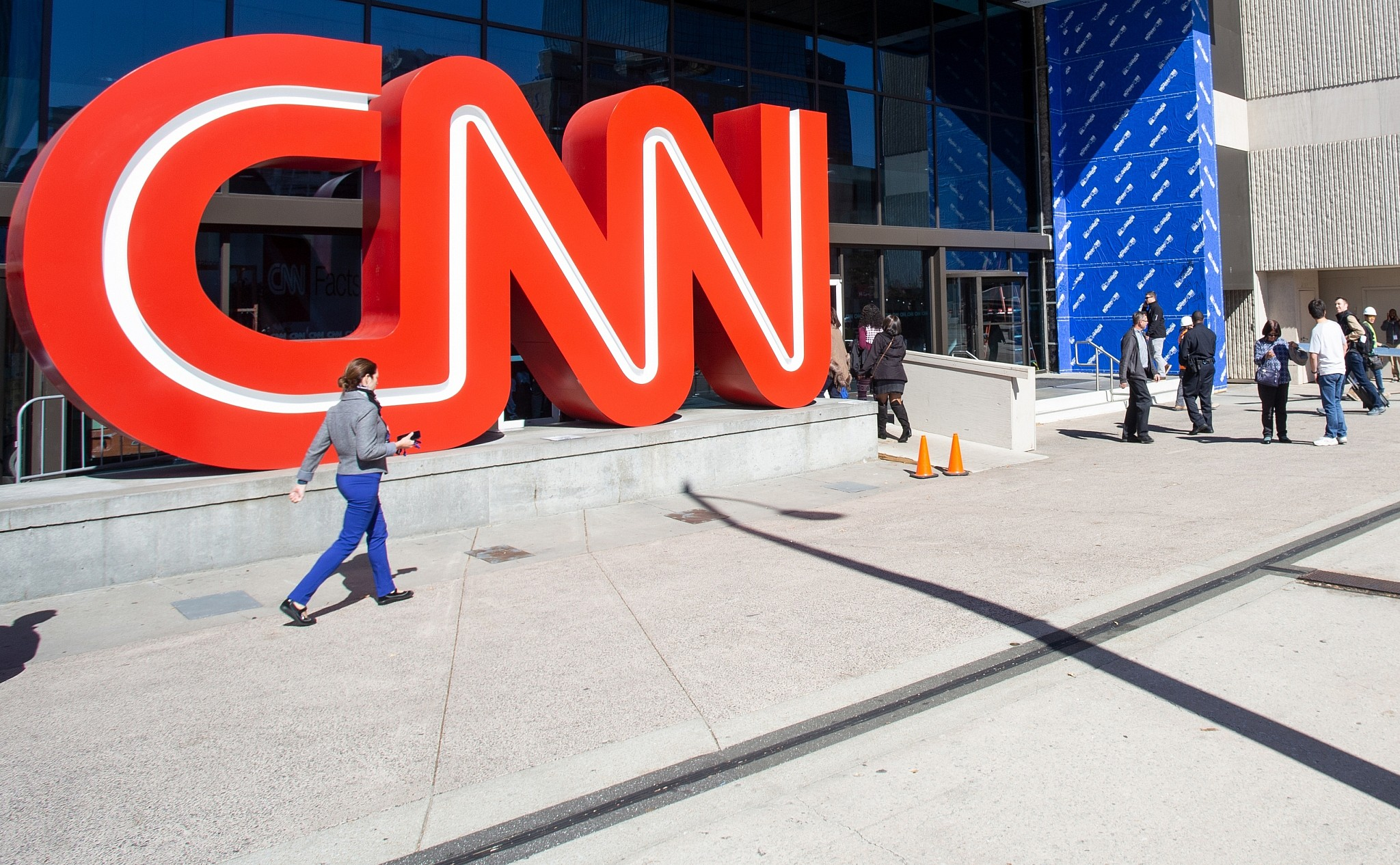 People walk outside CNN Center in Atlanta
