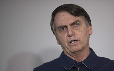Presidential candidate Jair Bolsonaro, of the far-right Social Liberal Party, speaks during a press conference in Rio de Janeiro, Brazil, Oct. 25, 2018 (AP Photo/Leo Correa)