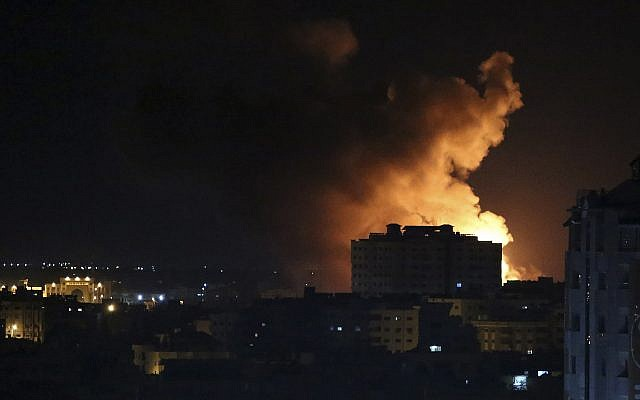 Smoke rises from an explosion caused by an Israeli airstrike on Gaza City, early Saturday, Oct. 27, 2018 (AP Photo/Adel Hana)