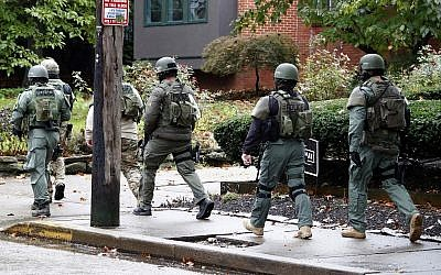 A SWAT team arrives at the Tree of Life Synagogue in Pittsburgh, Pennsylvania, where a shooter opened fire killing and injuring multiple people, Saturday, October 27, 2018. (AP/Gene J. Puskar)