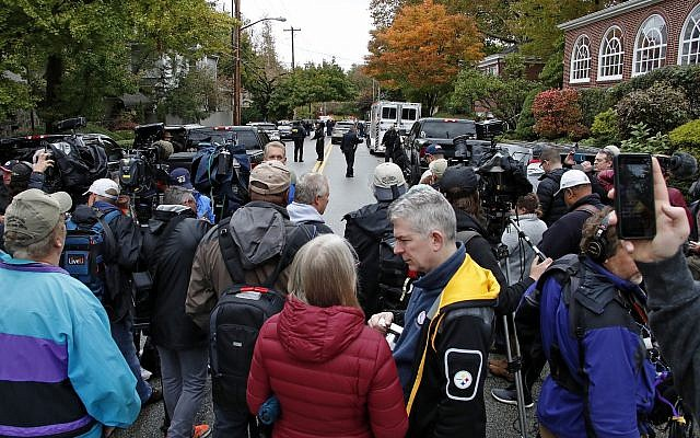 A crowd of media wait in the street two blocks from the Tree of Life Synagogue in Pittsburgh, where a shooter killed 11 people on Saturday, Oct. 27, 2018. (AP/Gene J. Puskar)