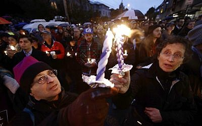 People light candles as they gather for a vigil in the aftermath of a deadly shooting at the Tree of Life Congregation, in the Squirrel Hill neighborhood of Pittsburgh, Saturday, Oct. 27, 2018. (AP/Matt Rourke)