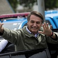 Jair Bolsonaro, presidential candidate with the Social Liberal Party, waves after voting in the presidential runoff election in Rio de Janeiro, Brazil, Oct. 28, 2018 (AP Photo/Silvia izquierdo)