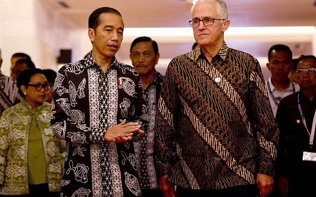 "Indonesia President Joko ""Jokowi"" Widodo, front left, walks with Australia former Prime Minister Malcolm Turnbull, front right, during their bilateral meeting at Our Ocean Conference in Bali, Indonesia Monday, Oct. 29, 2018.(AP Photo/Firdia Lisnawati)"