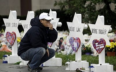 A person pauses in front of Stars of David with the names of those killed two days earlier in a deadly shooting at the Tree of Life Synagogue, in Pittsburgh, October 29, 2018. (Matt Rourke/AP)