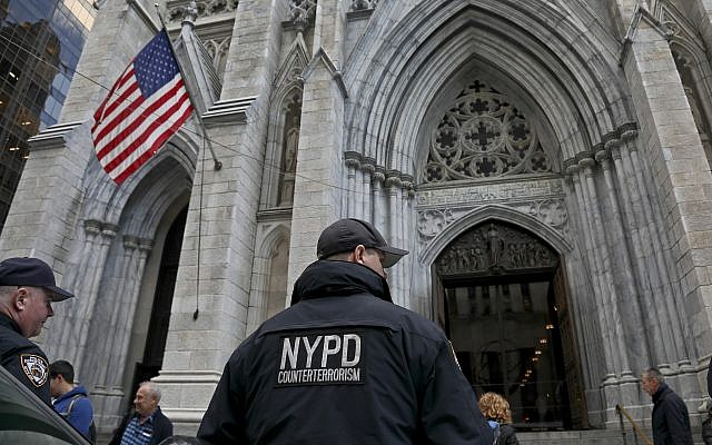 NYPD counterterrorism officers are stationed at St. Patrick's Cathedral, as religious institutions boost security in the aftermath of Pittsburgh's Synagogue shooting, October 29, 2018, in New York. (AP Photo/Bebeto Matthews)