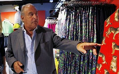 Sir Philip Green, a British billionaire and the CEO of the Arcadia Group, right, tours a Topshop store in central Hong Kong, June 5, 2013 (AP Photo/Kin Cheung)