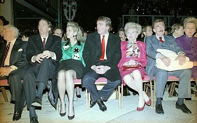 Donald Trump, center, sits with hands folded at the Trump Taj Mahal in Atlantic City, New Jersey, April 6, 1990, before the start of grand opening ceremonies. Trump (C) attended the gala with his parents, Mary (3rd R) and Fred (2nd R), and sister US District Court Judge Maryanne Trump Barry (R), and brother Robert Trump (L) and his wife Blaine Trump (3rd L). Trump was dateless. (AP Photo/Charles Rex Arbogast)