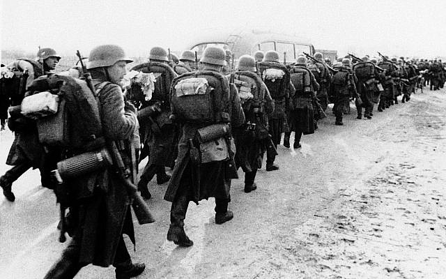 Nazi soldiers on the march over an unnamed road in Denmark, April 9, 1940, seized by Germany in a sudden thrust toward Scandinavian points. (AP Photo)