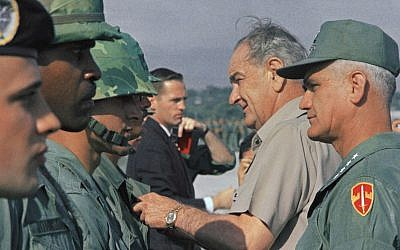 US president Lyndon Johnson (2R) and Gen. William C. Westmoreland (R), commander of US forces in Vietnam, on December 25, 1967. (AP Photo/File)