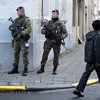 File: Belgian para-commandos patrol near a synagogue in the center of Antwerp, Belgium, on Saturday, January 17, 2015. (AP Photo/Virginia Mayo)