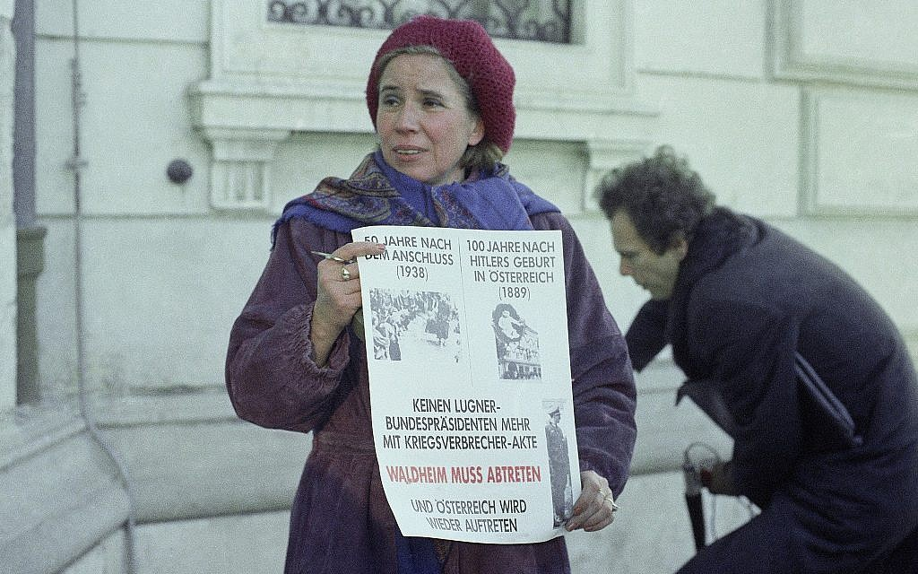 "Nazi hunter Beate Klarsfeld stages a protest against Austrian President Kurt Waldheim in front of his presidential offices in Vienna, Thursday, Dec. 10, 1987. She holds a sign saying in part ""No Liar as President with War Criminal Files."" (AP Photo/Martha Hermann)"