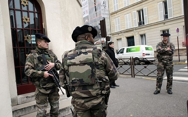 Soldiers stand guard outside a synagogue in Neuilly sur Seine, outside, Paris, France, Tuesday, Jan. 13, 2015. (AP /Christophe Ena)