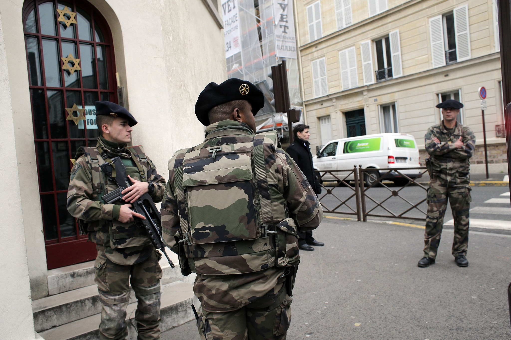 Soldiers stand guard outside a synagogue in Neuilly sur Seine outside Paris France Tuesday Jan. 13 2015