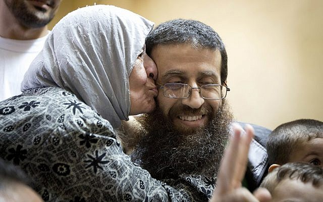 Palestinian Khader Adnan is greeted after his release from an Israeli prison in the West Bank village of Arrabeh near Jenin, July 12, 2015.  (AP Photo/Majdi Mohammed/File)