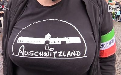 Screen capture from video Selene Ticchi, an activist with the Italian neo-fascist Forza Nuova movement, wears a t-shirt with the slogan 'Asuchwitzland' on it at a rally in the northeast town of Predappio, October 28, 2018. (YouTube)