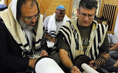 Orthodox Jews read the morning Torah portion at the Jewish Community Center in Larnaca, Cyprus. (Larry Luxner/ Times of Israel)