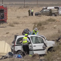 The scene of a deadly crash between a car and a bus on Route 90 near the Dead Sea on October 18, 2018. (Screen capture: Israel Police)