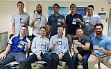 Ten American baseball players show off their new national identity cards after receiving Israeli citizenship at the Population and Immigration Authority offices in Jaffa on October 17, 2018. (Israel Baseball via JTA)