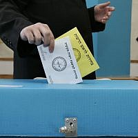 Man voting in the town of Beit Shemesh. (Nati Shohat/Flash 90)