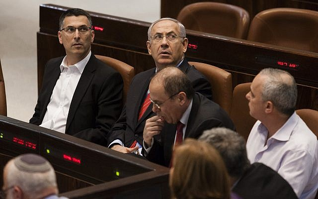 Prime Minister Benjamin Netanyahu 2nd left, and then Interior Minister Gideon Sa'ar, left, attend a session of the Knesset, in Jerusalem, on March 19, 2013. (Flash 90)