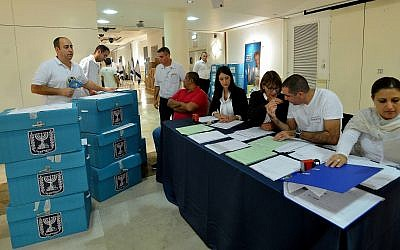 Ballot boxes filled with votes from nationwide municipal elections are brought to the Central Election Committee headquarters for counting, October 22, 2013. (Yossi Zeliger/FLASH90)