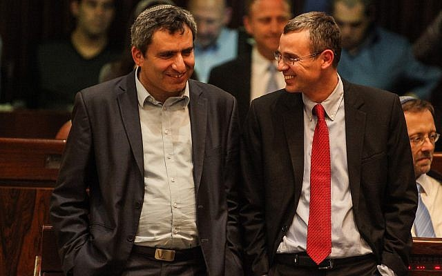 Yariv Levin, right, and Ze'ev Elkin of the Likud party attend a Knesset plenum session on March 12, 2014. (Flash90)