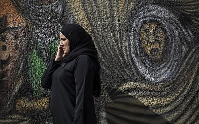 A Palestinian woman speaks on a cell phone in Ramallah on October 28, 2014.  (Hadas Parush/Flash90)