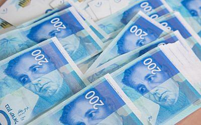 Illustrative photo of 200 New Israeli Shekel bills, February 7, 2016. (Nati Shohat/Flash90)