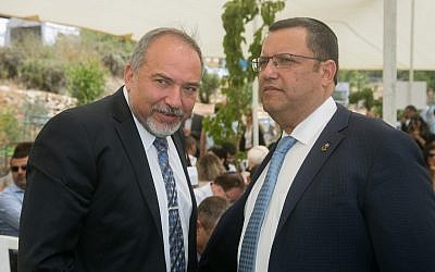 Defense Minister Avigdor Liberman (L) speaks with Moshe Lion (R) during a special cabinet meeting for Jerusalem day in Ein Lavan spring in Jerusalem on June 2, 2016. (Marc Israel Sellem/POOL)