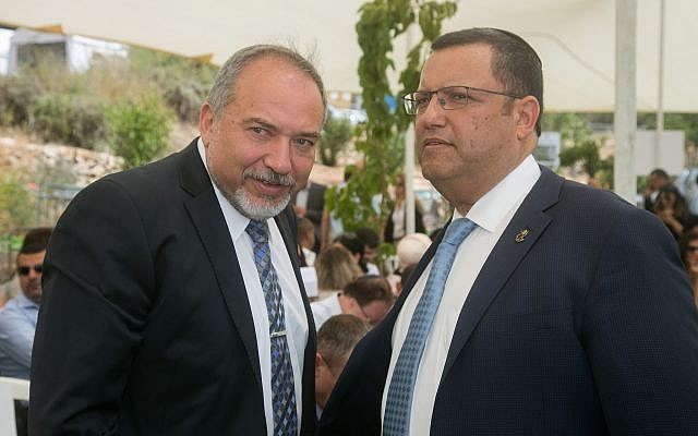 Defense Minister Avigdor Liberman (L) speaks with Moshe Lion (R) during a special cabinet meeting for Jerusalem day in Ein Lavan spring in Jerusalem on June 2, 2016. (Marc Israel Sellem/POOL)
