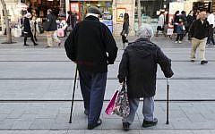 An elderly couple walk on Jaffa street in downtown Jerusalem on February 20, 2017. (Nati Shohat/Flash90)