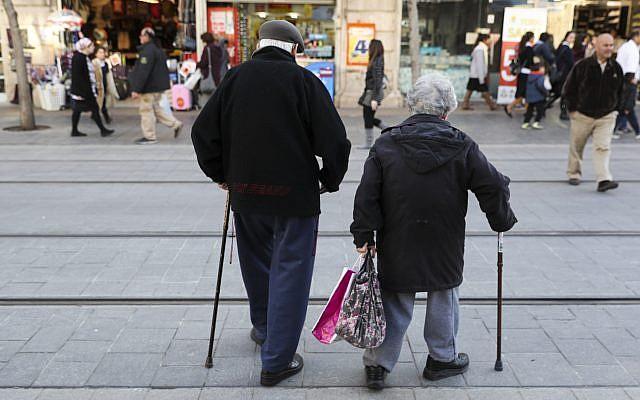 An elderly couple walk on Jaffa street in downtown Jerusalem on February 20, 2017. (Nati Shohat/Flash90)