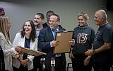 Communications Minister Ayoub Kara with representatives of the Reshet (R) and Keshet (L) media companies during a ceremony awarding broadcasting licenses for new channels 12 and 13 in Jerusalem, following Channel 2's split, on October 31, 2017. (Yonatan Sindel/Flash90)