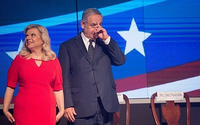 Prime Minister Benjamin Netanyahu and his wife Sara Netanyahu attend a US Independence Day celebration at Avenue in Airport City, on July 3, 2018. (Miriam Alster/Flash90)
