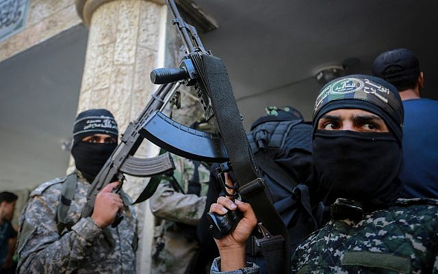 Fighters from the Hamas terror group at a funeral in Gaza City on September 25, 2018, for a 21-year-old Palestinian who died the day before in clashes with Israeli troops along the border. (Abed Rahim Khatib/Flash90)
