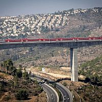 View of the new Tel Aviv-Jerusalem fast train seen over the Ha'Arazim valley just outside of Jerusalem, September 25, 2018 (Yossi Zamir/Flash90)