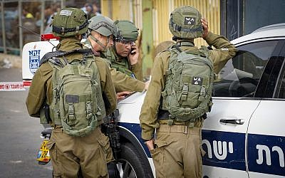 Israeli security forces at the scene of a shooting attack in Barkan industrial zone in the West Bank on October 7, 2018 (Flash90)