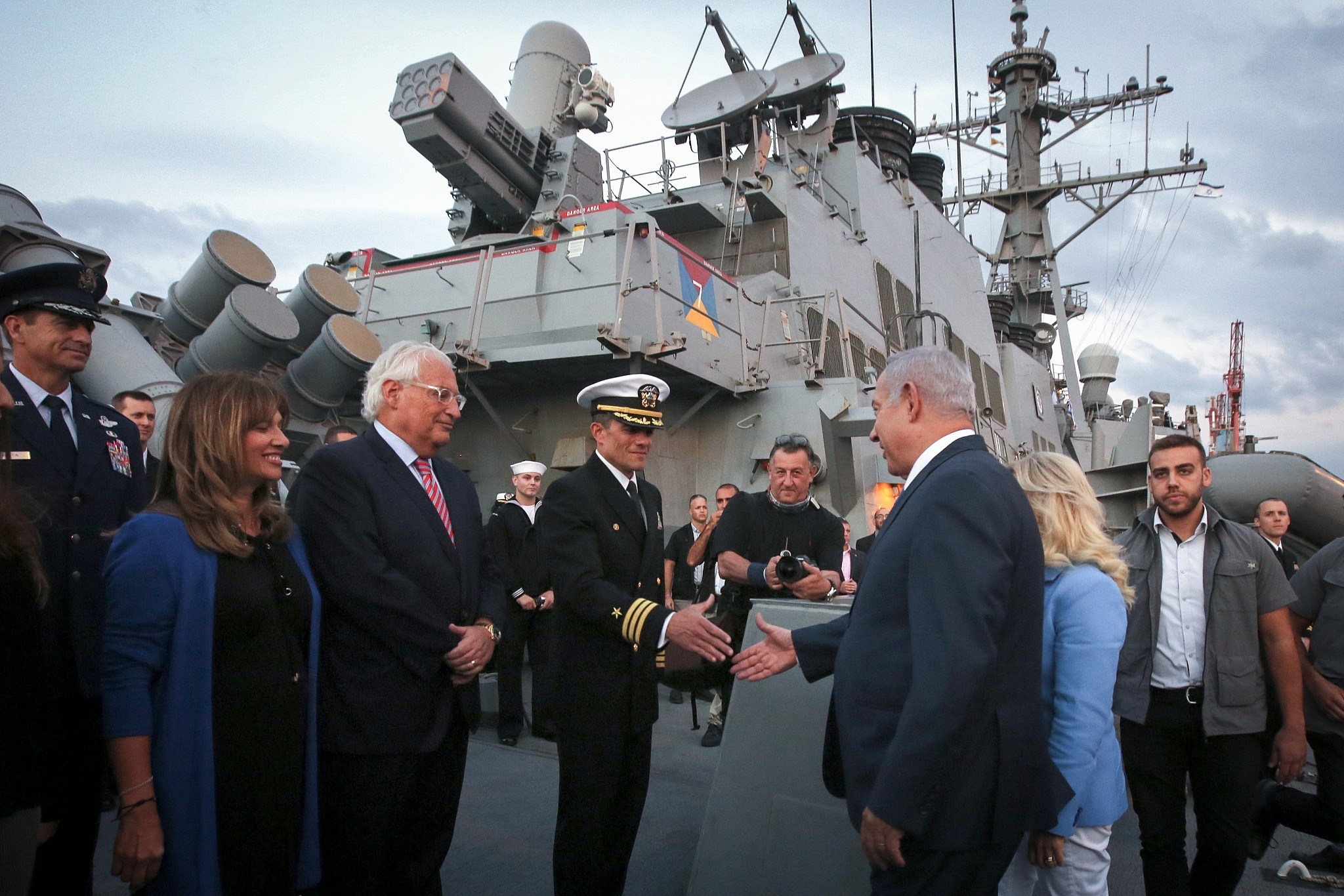 Prime Minister Benjamin Netanyahu third right and US Ambassador David Friedman third left aboard the US Navy's guided-missile destroyer USS Ross docked at Ashdod Port